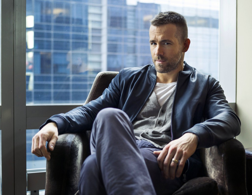 """In this Feb. 26, 2015 photo, Canadian actor Ryan Reynolds poses for a portrait to promote his upcoming film """"Woman in Gold"""" in New York. Reynolds stars with Helen Mirren and Katie Holmes, in the film released on April 3. (Photo by Victoria Will/Invision/AP)"""