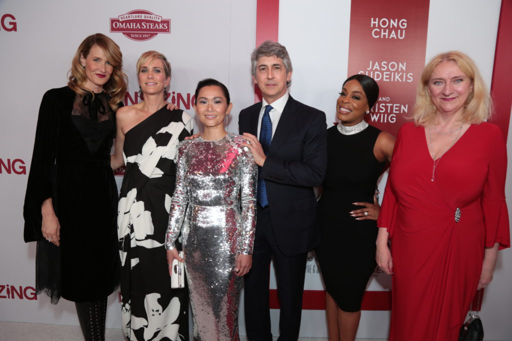 "Laura Dern, Kristen Wiig, Hong Chau, Alexander Payne, Neicy Nash and Margareta Pettersson pose together as Paramount Pictures presents a special screening of ""Downsizing"" in Los Angeles, CA at the Regency Village Theater in Los Angeles, CA on Monday, December 18, 2017..(Photo: Alex J. Berliner/ABImages)"